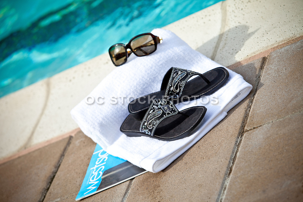 Resort Sandals And Sunglasses At The Pool