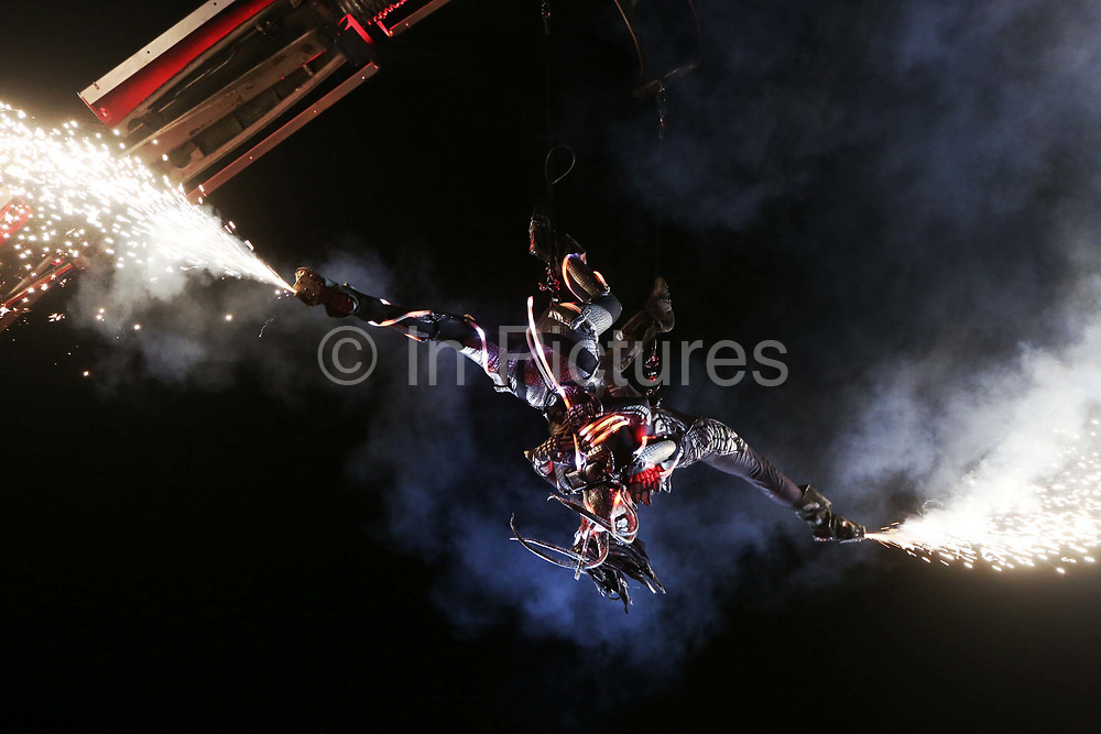 Arcadia, a show by Mutoid Waste Company at Glastonbury Festival in Glastonbury, United Kingdom. The giant robot spider at Arcadia is also a DJ booth and the warmup to the fire breathing performance with spinning artists and a dancer throwing real electric lightning bolts. Glastonbury Festival is a five-day festival of contemporary performing arts that takes place near Pilton, Somerset. In addition to contemporary music, the festival hosts many other arts.