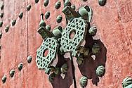 Iron door knob on a wooden, moroccan door, in Mèknes, Morocco.