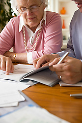 Portrait of a bussinessman and woman sitting and looking at documents