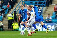 Rochdale midfielder Matt Done (16) and Gillingham FC midfielder Mark Byrne (33) during the EFL Sky Bet League 1 match between Gillingham and Rochdale at the MEMS Priestfield Stadium, Gillingham, England on 30 March 2019.
