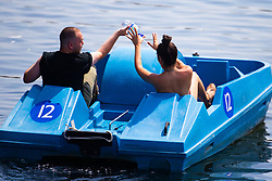 A couple have a water fight on a boat on The Serpentine in Hyde Park as another heatwave day begins with temperatures expected to soar. London, July 01 2018.