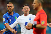 Wayne Rooney of England complains to the referee about being held by Daniele De Rossi of Italy