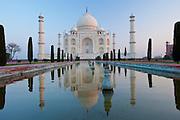 The Taj Mahal mausoleum southern view with reflecting pool and cypress trees, Uttar Pradesh, India
