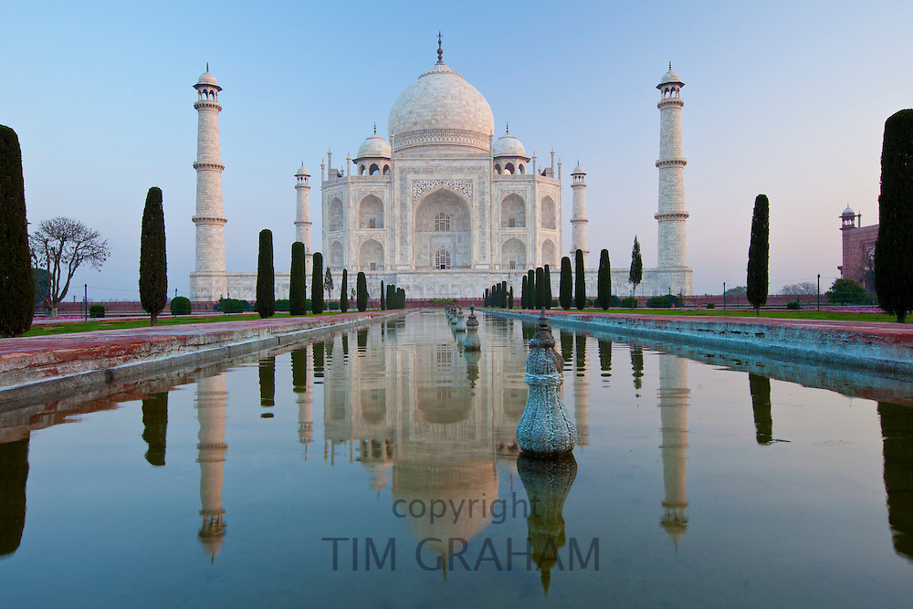 The Taj Mahal mausoleum southern view with reflecting pool and cypress trees, Uttar Pradesh, India