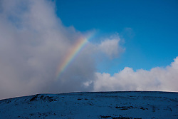 © Licensed to London News Pictures. 21/01/2021. Rhayader, Powys, Wales, UK. A rainbow is seen above a wintry landscape in the Elan Valley near Rhayader, Powys, UK. after overnight snow fell in Powys, Wales, UK. Photo credit: Graham M. Lawrence/LNP