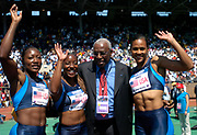 IAAF President Lamine Diack poses with the victorious USA Red women's 4 x 100-meter relay team (from left) Chryste Gaines, Inger Miller and Marion Jones during the USA vs. The World Competition at the 110th Penn Relays at the University of Pennsylvania's Franklin Field on Saturday, April 24, 2004 in Philadelphia.