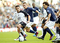 30/10/2004<br />FA Barclays Premiership - Fulham v Tottenham Hotspur - Craven Cottage, London<br />Fulham's Steed Malbranque gets the ball away from former team mate Tottenham Hotspur's Sean Davis (behind) and Simon Davies (r)<br />Photo:Jed Leicester/Back Page Images