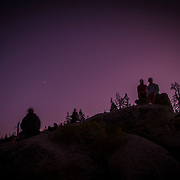 People watch stars after sunset at Glacier Point inside Yosemite National Park on Sunday, September 22, 2019 in Yosemite, California. (Alex Menendez via AP)