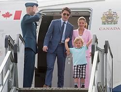 Hadrian Trudeau leads his parents, Prime Minister Justin Trudeau and his wife, Sophie Gregoire off the plane as they arrive Wednesday, July 5, 2017 in Edinburgh.Photo by Ryan Remiorz/The Canadian Press/ABACAPRESS.COM
