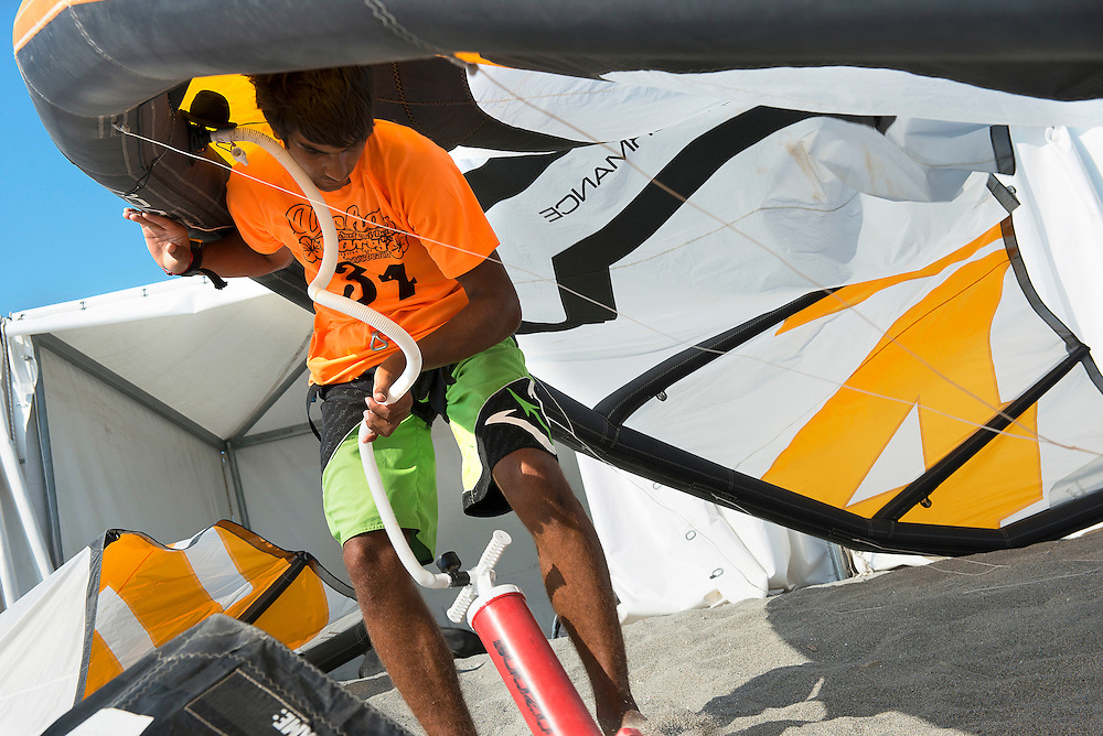Surfer blows up his kite before the race at European Kiteracing Championship, Calabria (IT)