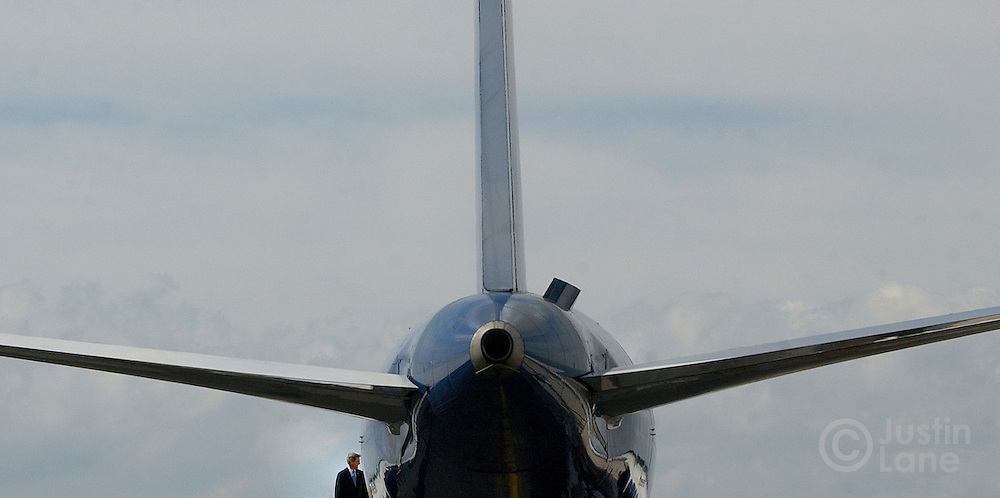 United States Senator and Democratic Candidate for President John Kerry, bottom left, exits his campaign plane in Tampa, FL where he attened an event at the Tampa Bay Performing Arts Center in Tampa, FL Monday, 18 Oct, 2004. ..EPA/JUSTIN LANE