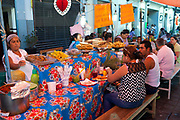 Locals eat at a street food market. Oaxaca is known throughout Mexico and internationally for it's great food. Seen as a centre for Mexican cuisine, among other regional specialities the dish the area is best known for is called Mole.