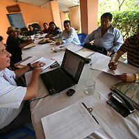 Erich Eger (L) a FLO CERT auditor, meets with the board of the El Jabali coop. The criteria for certification with FLO CERT are extensive and demanding and the board of the coop meets with the auditor for two days including field visits. Cooperativa El Jabali is a certified Fairtrade coffee producer based in El Salvador.
