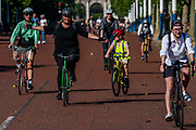 Enjoying cycling on The Mall as the sun comes out again. The 'lockdown' continues for the Coronavirus (Covid 19) outbreak in London.