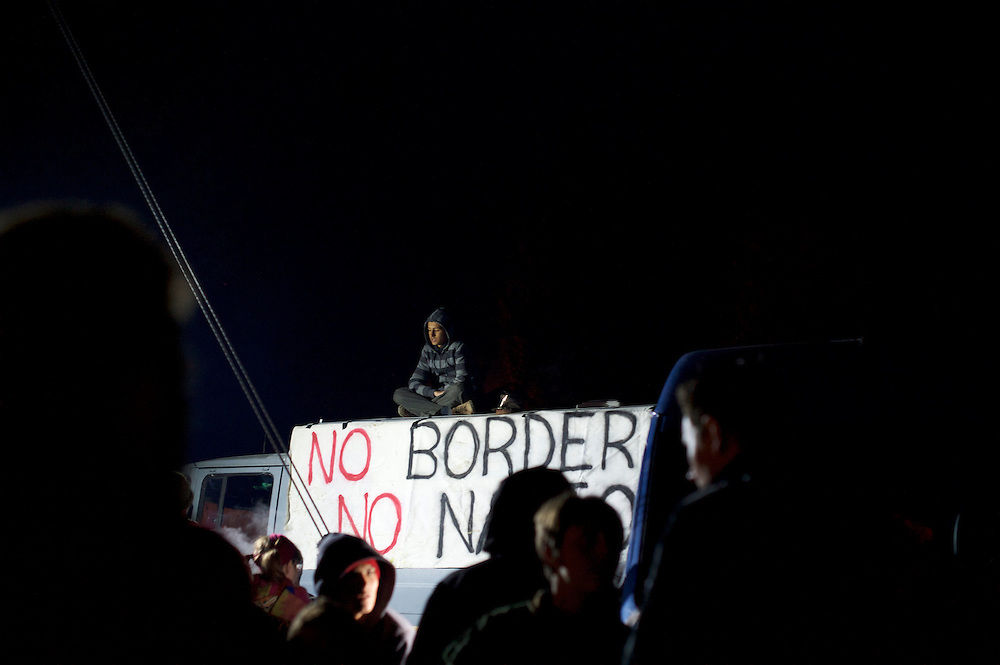 Migrants protest against the closure of the border between Greece and Macedonia in Idomeni, Greece. Around 13,000 migrants and refugees, mostly from the Middle East and African nations, are believe to be stranded here awaiting a chance to proceed their journey towards Germany and other northern European countries.