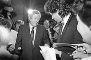 Bob Geldof Receives F.A.O. Medal.<br /> 1986.<br /> 16.10.1986.<br /> 10.16.1986.<br /> 16th October 1986.<br /> The highlight of Gorta's 21st anniversary World Food Day was the presentation of an F.A.O.(Food and Agriculture Organisation of the United Nations) to Bob Geldof. The medal was presented by An Taoiseach,Dr Garret Fitzgerald. The medal was in recognition of Bob's efforts and contribution towards famine relief in the Third World. The ceremony took place in The Berkeley Court Hotel in Dublin.<br /> <br /> In the midst of the media scrum, Bob is pictured meeting An Taoiseach, Dr Garret Fitzgerald. Bob still has the time to sign his autograph for some of the fans present.
