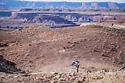 SHOT 10/15/16 4:31:30 PM - Paul Hobson of Steamboat Springs, Co. pauses while pushing his bike uphill during a climbing section along the White Rim Trail. The White Rim is a mountain biking trip in Canyonlands National Park just outside of Moab, Utah. The White Rim Road is a 71.2-mile-long unpaved four-wheel drive road that traverses the top of the White Rim Sandstone formation below the Island in the Sky mesa of Canyonlands National Park in southern Utah in the United States. The road was constructed in the 1950s by the Atomic Energy Commission to provide access for individual prospectors intent on mining uranium deposits for use in nuclear weapons production during the Cold War. Four-wheel drive vehicles and mountain bikes are the most common modes of transport though horseback riding and hiking are also permitted.<br /> (Photo by Marc Piscotty / © 2016)