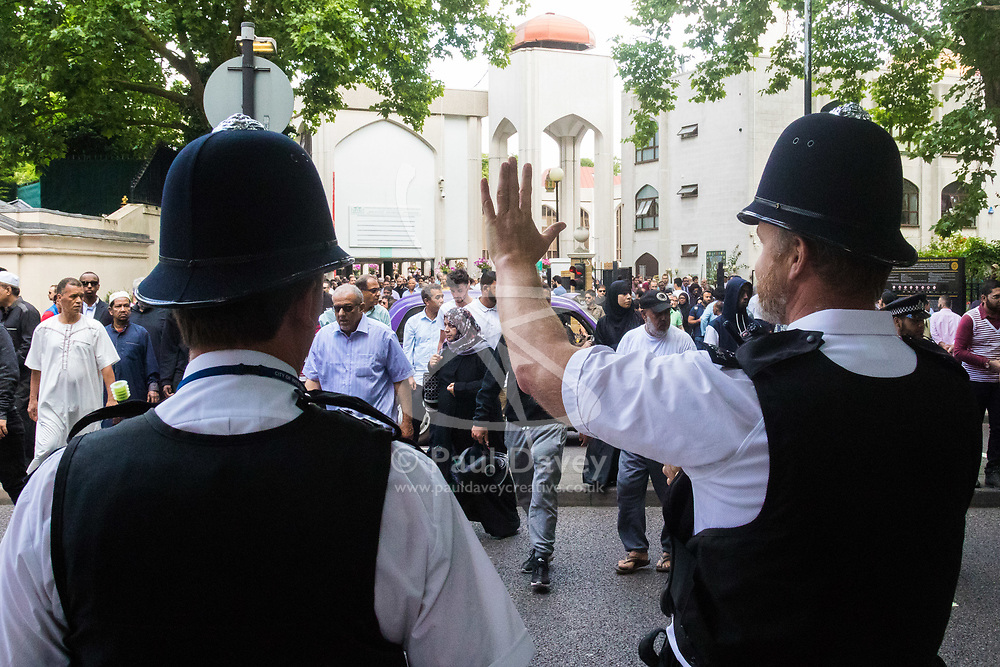 London, June 23rd 2017. Police are in evidence as Muslim worshippers gather for Friday Prayers at London Central Mosque in Regents Park, following the suspected terror attack in the early Hours of Monday June 19th when Darren Osbourne, 47, from Cardiff, now charged with terrorism-related murder, is alleged to have run down a group of Muslims in Finsbury Park. PICTURED: Met Police officers keep watch and direct traffic as Muslims leave the mosque.