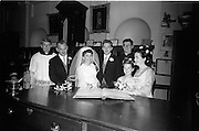 """16/09/1967<br /> 09/16/1967<br /> 16 September 1967<br /> Wedding of Mr Francis W. Moloney, 28 The Stiles Road, Clontarf and Ms Antoinette O'Carroll, """"Melrose"""", Leinster Road, Rathmines at Our Lady of Refuge Church, Rathmines, with reception in Colamore Hotel, Coliemore Road, Dalkey. Image shows the Bride and Groom signing the register are the wedding. Second from left is Michael Power and on right is Gladys McGloughlin."""