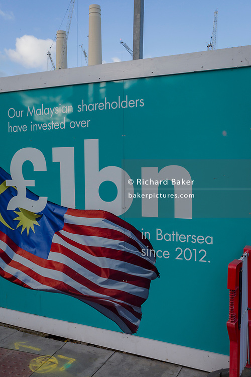 As on-going construction work in Battersea continues, a hoarding mentions the £1 billion investment by Malaysia at the Battersea Power Station development project, on 22 January 2018, in south London, England.