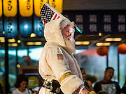 17 SEPTEMBER 2015 - BANGKOK, THAILAND: DOUGLAS GOWIN, a Santa Claus from the US, walks into the World Santa Claus Congress in Bangkok. Twenty-six Santa Clauses from around the world are in Bangkok for the first World Santa Claus Congress. The World Santa Claus Congress has been an annual event in Denmark since 1957. This year's event, hosted by Snow Town, a theme park with a winter and snow theme, hosted the event. There were Santas from Japan, Hong Kong, the US, Canada, Germany, France and Denmark. They presented gifts to Thai children and judged a Santa pageant. Thailand, a Buddhist country, does not celebrate the religious aspects of Christmas, but Thais do celebrate the commercial aspects of the holiday.    PHOTO BY JACK KURTZ