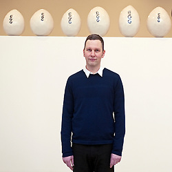 © London News PIctures. 31/01/2012. Artist David Shrigley poses next to artwork titled '12 Large Eggs (2011)' at a press viewing of exhibition 'Brain Activity, by British artist David Shrigley at the Hayward Gallery, London on January 31st, 2012. Photo credit: Ben Cawthra/LNP