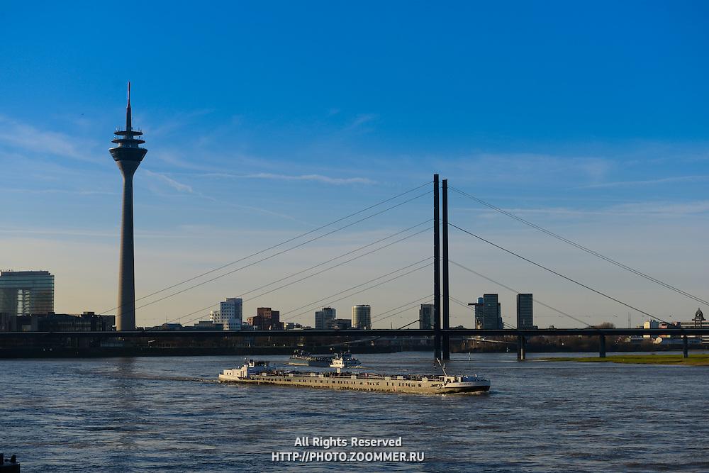 Barge On Rhine river under the bridge,  Dusseldorf, Germany