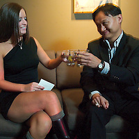 (PFEATURES) Atlantic City 10/23/2003  High Roller James Kwasnik toasts his drink with Club MIXX private room hostes _____   James has ID    Michael J. Treola Staff Photographer....MJT