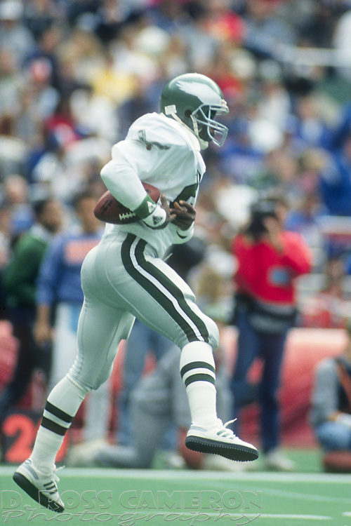 Philadelphia Eagles punt returner Mark Higgs leaves his feet to corral the ball during an NFL football game against the New York Giants, Sunday, Oct. 8, 1989 at Veterans Stadium in Philadelphia, Pa. The Eagles won, 21-19. (Photo by D. Ross Cameron)