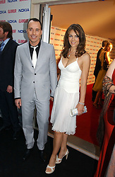 DAVID FURNISH and LIZ HURLEY at the 2006 Glamour Women of the Year Awards 2006 held in Berkeley Square Gardens, London W1 on 6th June 2006.<br /><br />NON EXCLUSIVE - WORLD RIGHTS