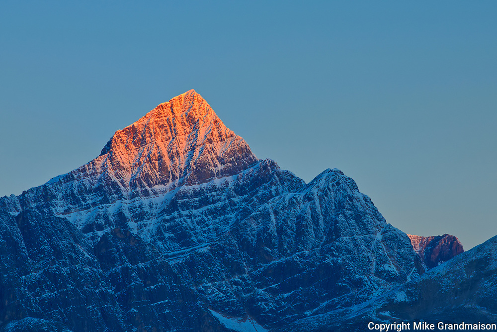 First light on a peak of the Canadina Rocky Mountains. Icefields Parkway.<br />Jasper National Park<br />Alberta<br />Canada
