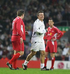 LIVERPOOL, ENGLAND - SUNDAY MARCH 27th 2005: Liverpool Legends' Jan Mølby and Celebrity XI's Shane Ritchie compete for the biggest belly during the Tsunami Soccer Aid match at Anfield. (Pic by David Rawcliffe/Propaganda)