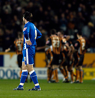 Photo: Jed Wee.<br />Hull City v Cardiff City. Coca Cola Championship.<br />03/12/2005.<br />Cardiff's Alan Lee has his hands on his hips in disappointment as in the background Hull celebrate their second goal.
