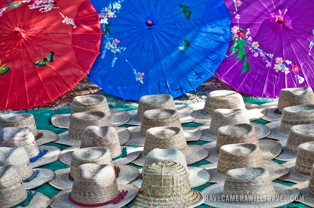 Tourist market selling straw hats and umbrellas as Chichen Itza, Mexico