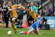 Harrison Dunk of Cambridge United tussles with Ben Davies of Portsmouth. Skybet football league two match, Cambridge Utd v Portsmouth at the Abbey Stadium  in Cambridge on Saturday 10th October 2015.<br /> pic by John Patrick Fletcher, Andrew Orchard sports photography.