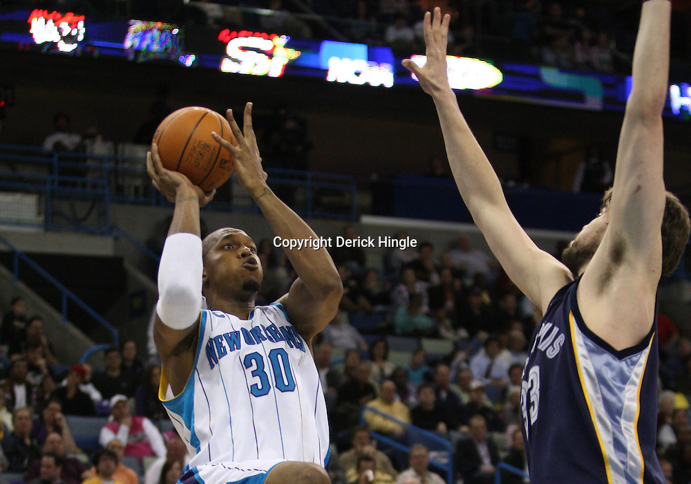 Mar 03, 2010; New Orleans, LA, USA; New Orleans Hornets forward David West (30) shoots over Memphis Grizzlies center Marc Gasol (33) during the second half at the New Orleans Arena. The Grizzlies defeated the Hornets 104-100. Mandatory Credit: Derick E. Hingle-US PRESSWIRE