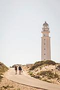Women walking by lighthouse at Cape Trafalgar in Spain