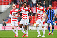 Mallik Wilks of Doncaster Rovers (7) scores a goal and celebrates with Ali Crawford of Doncaster Rovers (11) and John Marquis of Doncaster Rovers (9) to make the score 2-2 during the EFL Sky Bet League 1 match between Doncaster Rovers and Gillingham at the Keepmoat Stadium, Doncaster, England on 20 October 2018.