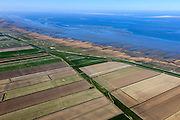 Nederland, Groningen, Gemeente Eemsmond, 01-05-2013; Waddenkust ten noorden van Uithuizen. Landaanwinning met opstrekkende verkaveling. Zicht op Rottumerplaat en Schiermonnikoog (li).<br /> Coast of the Waddensea (North Netherands) Land reclamation and view on isles Rottumerplaat en Schiermonnikoog. luchtfoto (toeslag op standard tarieven)<br /> aerial photo (additional fee required)<br /> copyright foto/photo Siebe Swart