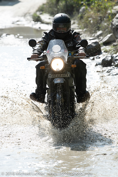 Kelly Modlin encountering a flooded piece of road on day-4 of our Himalayan Heroes adventure riding from Pokhara to Kalopani, Nepal. Friday, November 9, 2018. Photography ©2018 Michael Lichter.