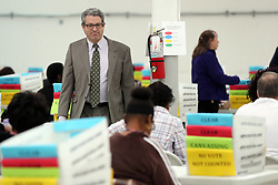 Assistant County Attorney Scott Andron walks the aisles before vote counting begins at the Broward County Supervisor of Elections office in Lauderhill on Friday, November 16, 2018. Photo by Amy Beth Bennett/South Florida Sun Sentinel/TNS/ABACAPRESS.COM