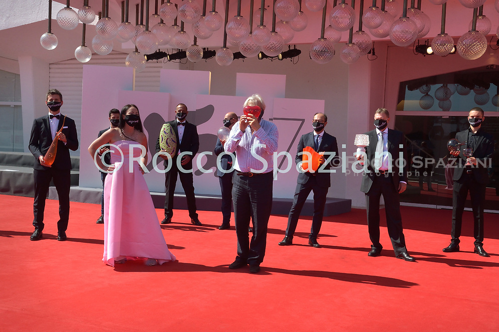 VENICE, ITALY - SEPTEMBER 08: Vittorio Sgarbi The art critic and member of the Italian parliament walks the red carpet together with entrepreneurs from Murano (Venice) famous for glass creations. At the 77th Venice Film Festival on September 09, 2020 in Venice, Italy. y.<br /> (Photo by Rocco Spaziani)