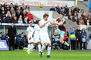 Swansea's Fernando Llorente (l) and Burnley's Joey Barton (r) challenge for a header. Premier league match, Swansea city v Burnley at the Liberty Stadium in Swansea, South Wales on Saturday 4th March 2017.<br /> pic by  Carl Robertson, Andrew Orchard sports photography.