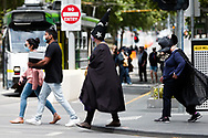 Witches' and Warlocks are seen crossing a street in the CBD during the COVID-19 in Melbourne. With over a week of zero cases in Victoria, Premier Daniel Andrews is expected to make major announcements on Sunday about further easing of restrictions. (Photo by Dave Hewison/Speed Media)