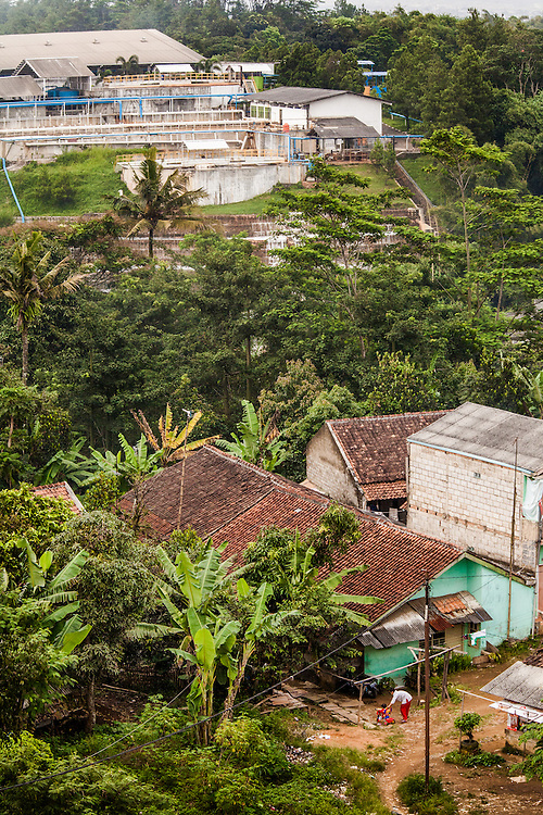 Gistex, a textile company that illegally dumps toxic wastes directly into the Citarum River.  The facility is located in the middle of residential homes.  Jelegong village, Kabupaten Bandung...Credit: Andri Tambunan for Greenpeace