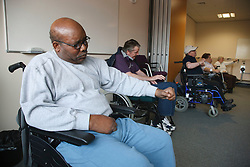 Exercise class for wheelchair users at Day Centre.