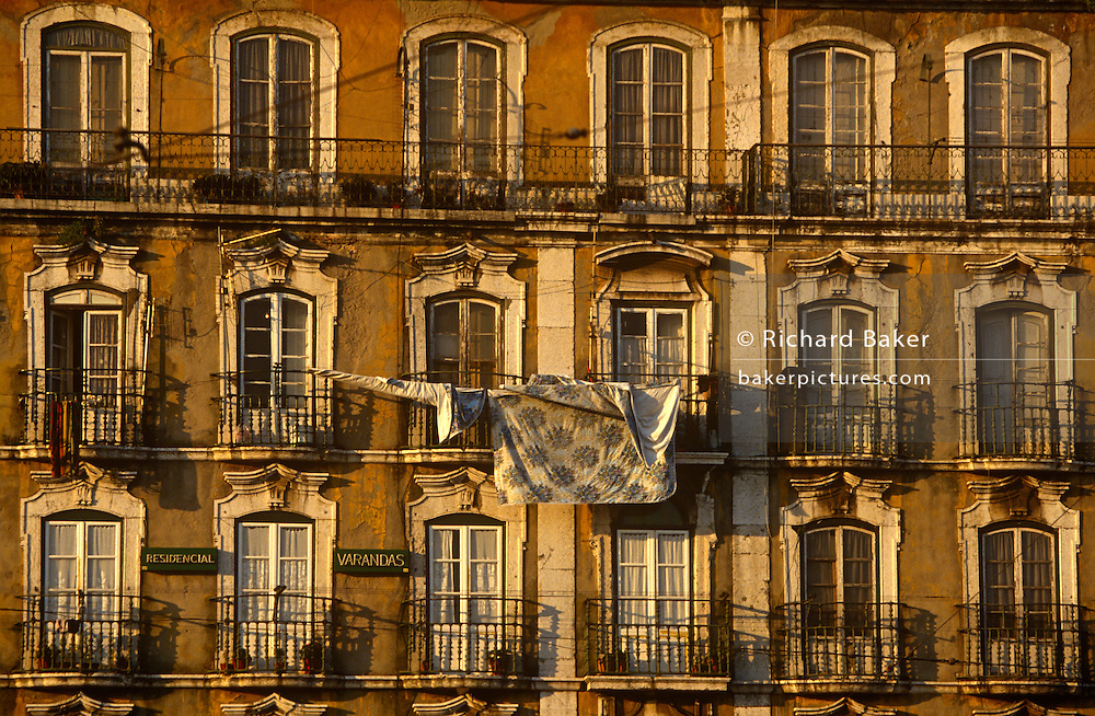 Washing hanging on old railings and balconies of Lisbon's old Alfama district.