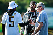 January 28 2016: NFL Vice President of Operations Merton Hanks talks with Buffaloe Bills quarterback Tyrod Taylor and unknown individual during the Pro Bowl practice at Turtle Bay Resort on North Shore Oahu, HI. (Photo by Aric Becker/Icon Sportswire)
