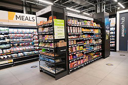 © Licensed to London News Pictures. 04/03/2021. London, UK. Aisles of grocery items inside first AMAZON GO grocery store in the UK opens in Ealing, West London. Shoppers need to use app to shop inside the store and pick up groceries without stopping to pay. Photo credit: London News Pictures
